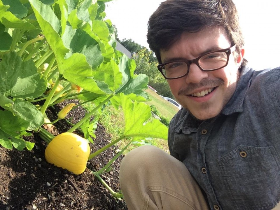 Will with one of the community garden`s growing pumpkins